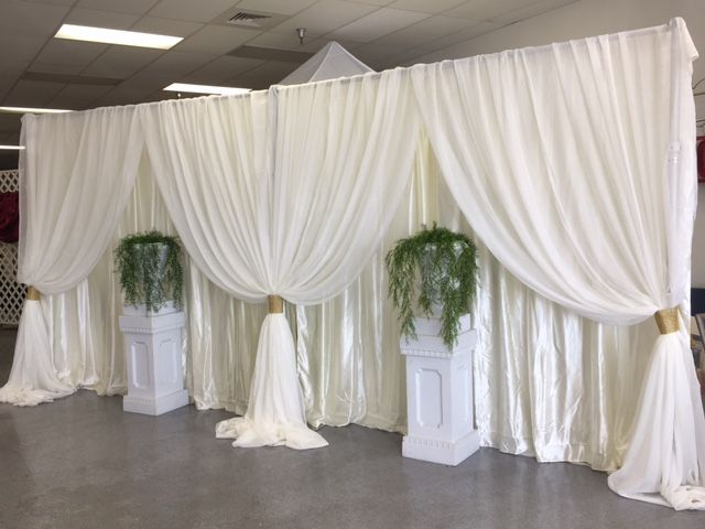 double ivory satin backdrop with sheer voile panels in front