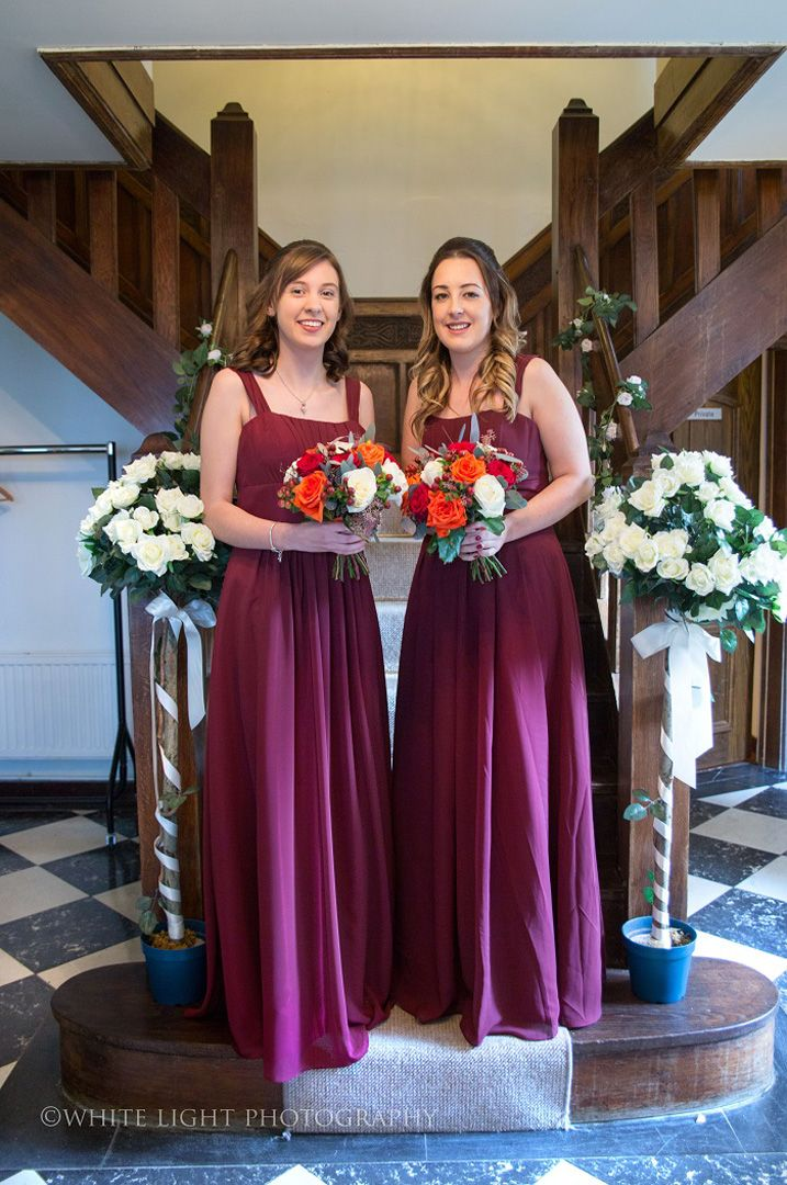 Burgundy bridesmaid dresses with orange bouquet | fall wedding bouquets