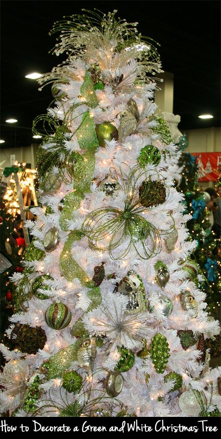 white christmas tree with red and green ornaments