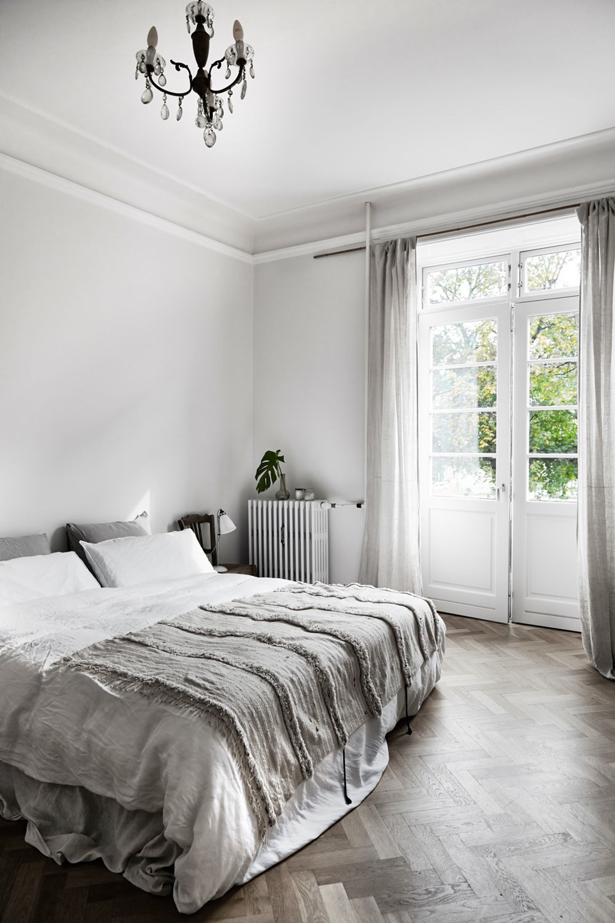 A beautiful and simple grey bedroom with grey bedding, light grey ...