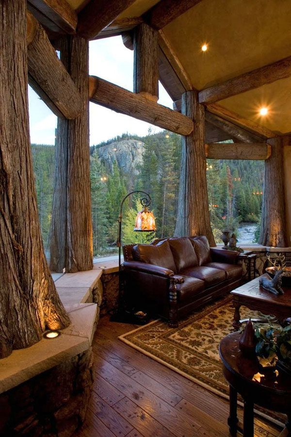 47 Extremely cozy and rustic cabin style living rooms-SR. love the logs framing all the windows.