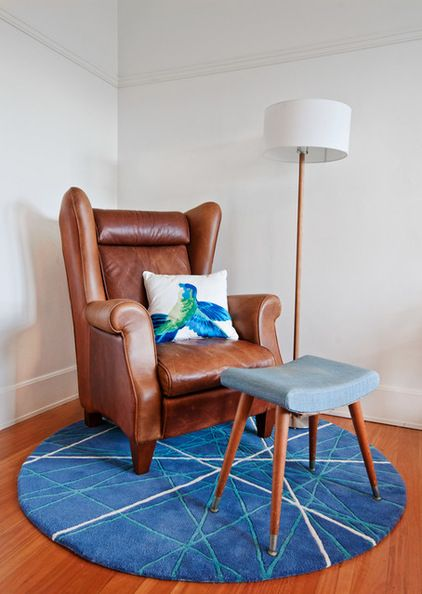 A Round Rug Under An Armchair Can Define A Reading Or Relaxing Nook Within A Larger Space Such As A Bedroom Or Round Rugs Scandinavian Furniture Round Carpets