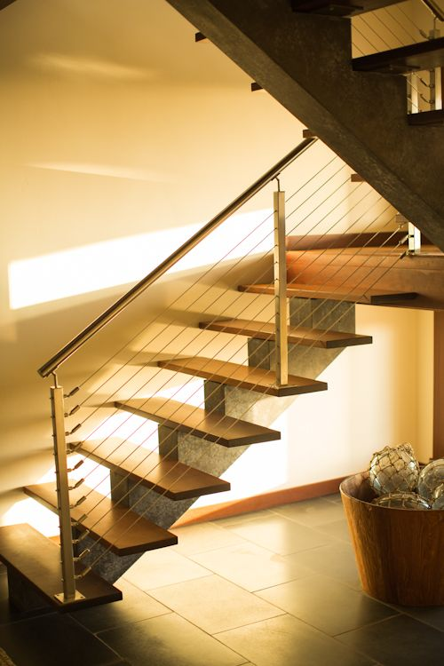 Modern Staircase With A Cast And Dyed Concrete Single Stringer