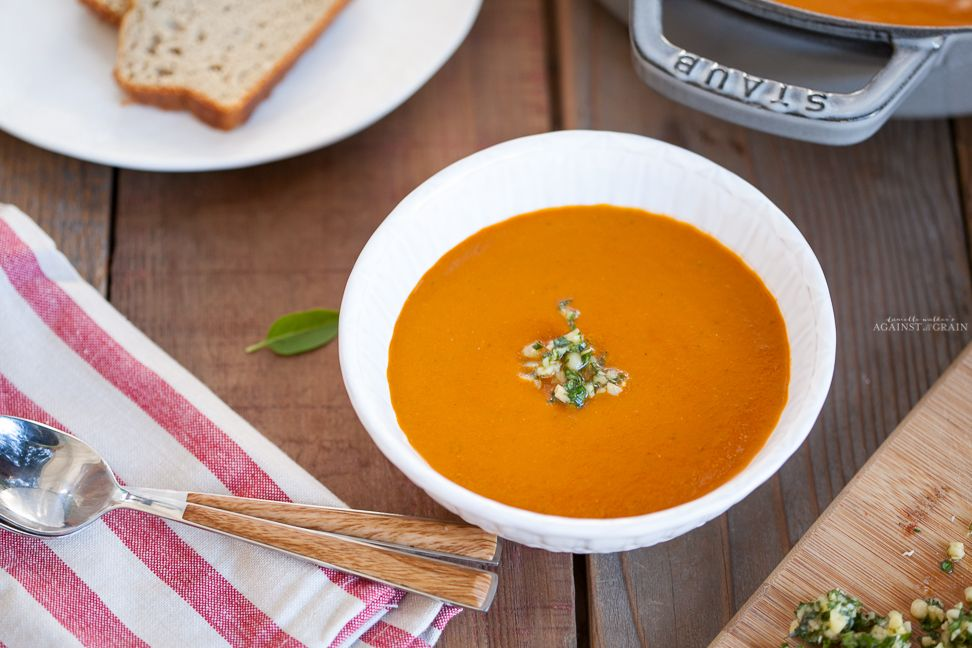This creamy dairy-free tomato soup recipe is both paleo and gluten-free and will be a favorite for your summer tomato produce haul!