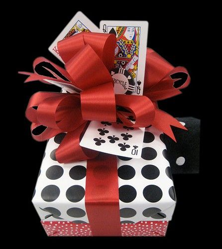 Use old, damaged playing cards as tags.  Link leads to LOADS of creative wrapping ideas =)