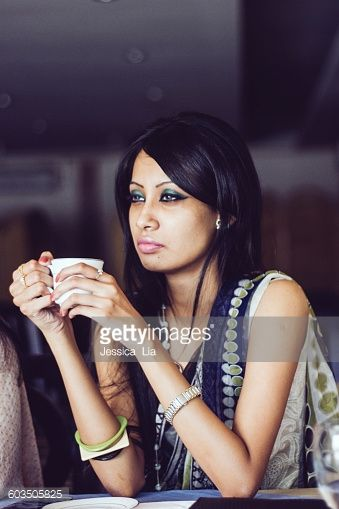 Stock Photo : Young indian woman alone in a cafe