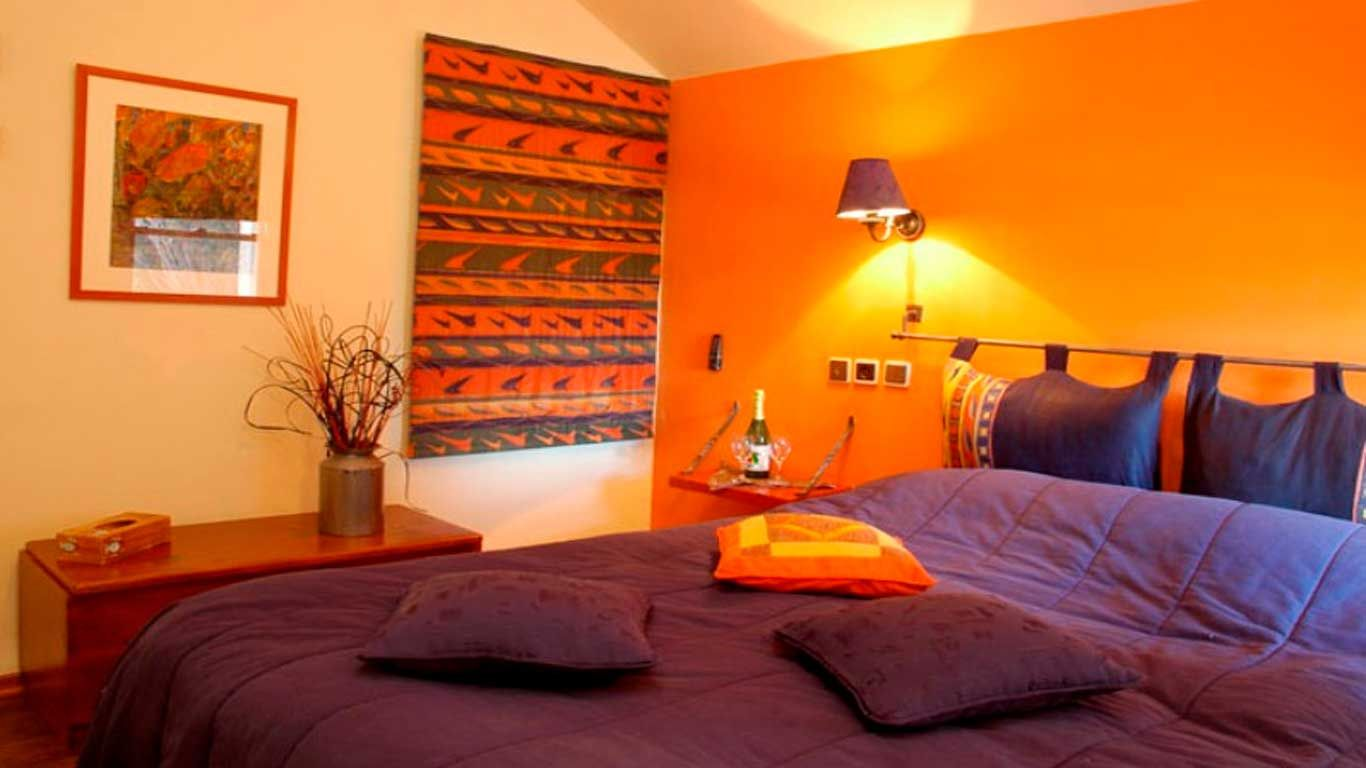 Bedroom interior wall decoration orange bed room interior design with modern interiors chennai