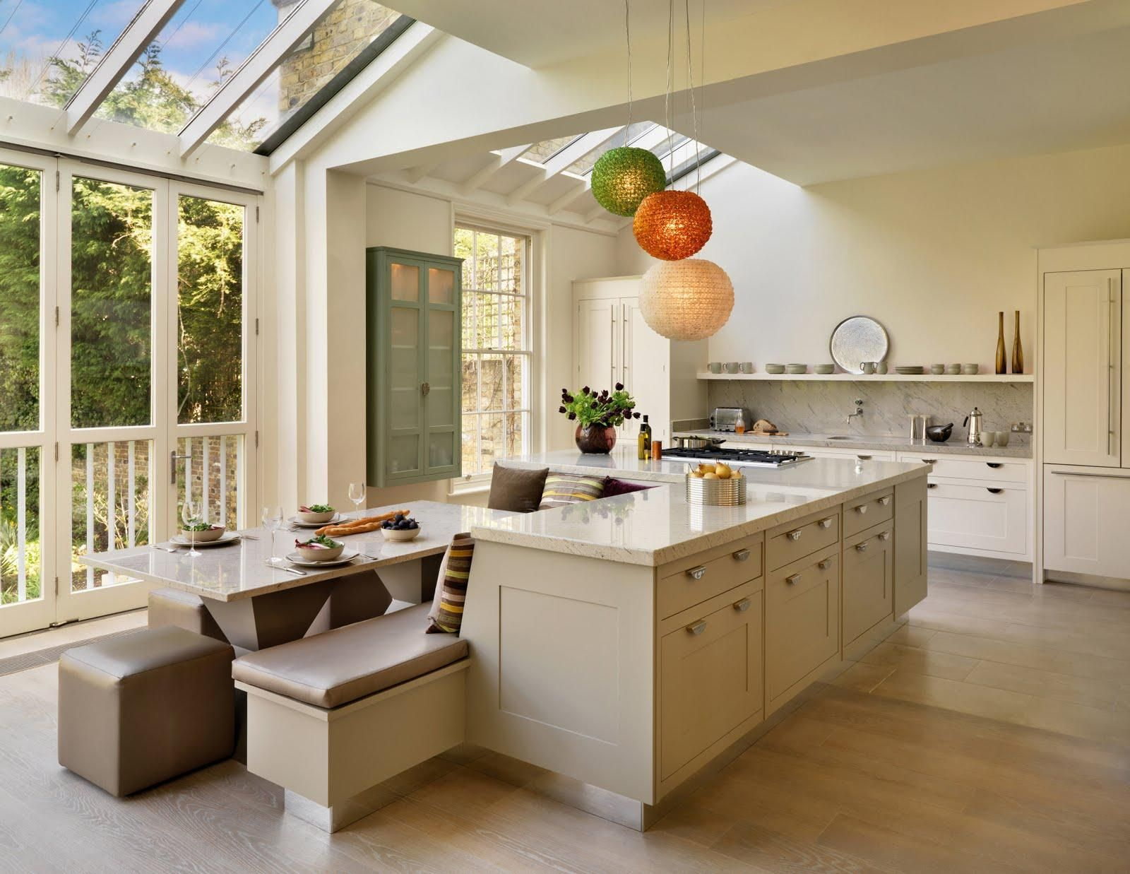 Bright kitchen interior with glass ceiling and wall with l shaped