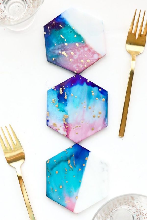 Beautiful coasters are like jewelry for your coffee table! And these DIY Coaster Ideas are sure to help you find a great accessory for your home. From gold splattered galaxy to watercolor designs, this collection is sure to hold the inspiration you've been looking for!