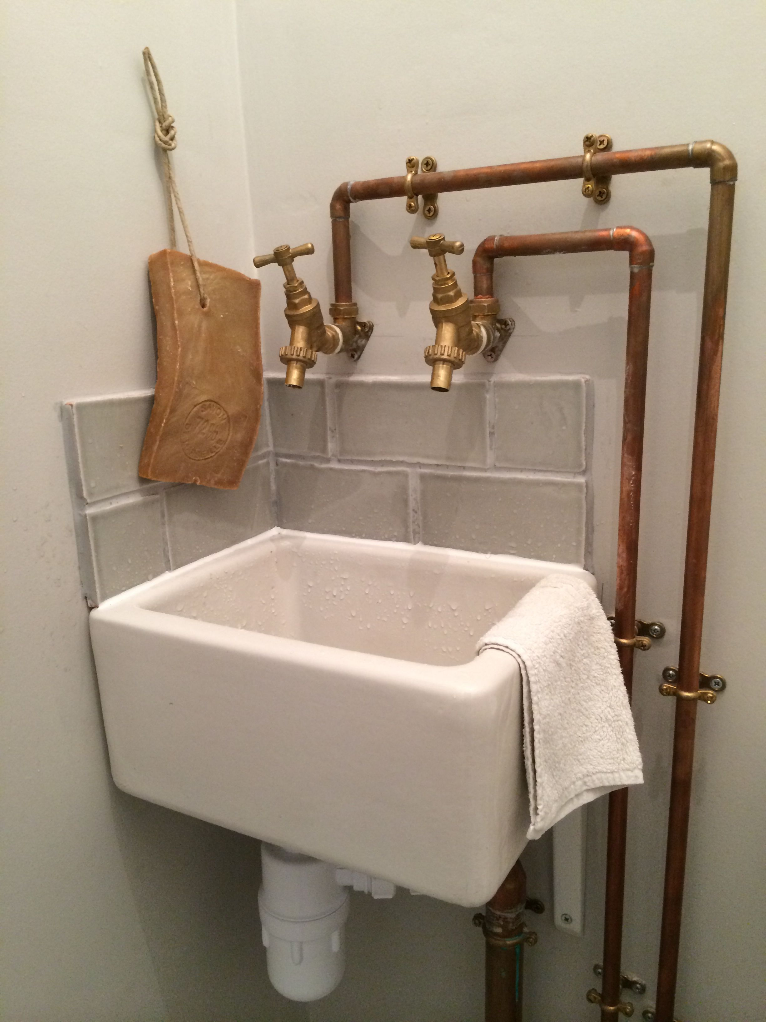 copper piping and baby belfast sink in cloakroom maybe a little copper piping and baby belfast sink in cloakroom maybe a little too rustic but i downstairs bathroomsmall