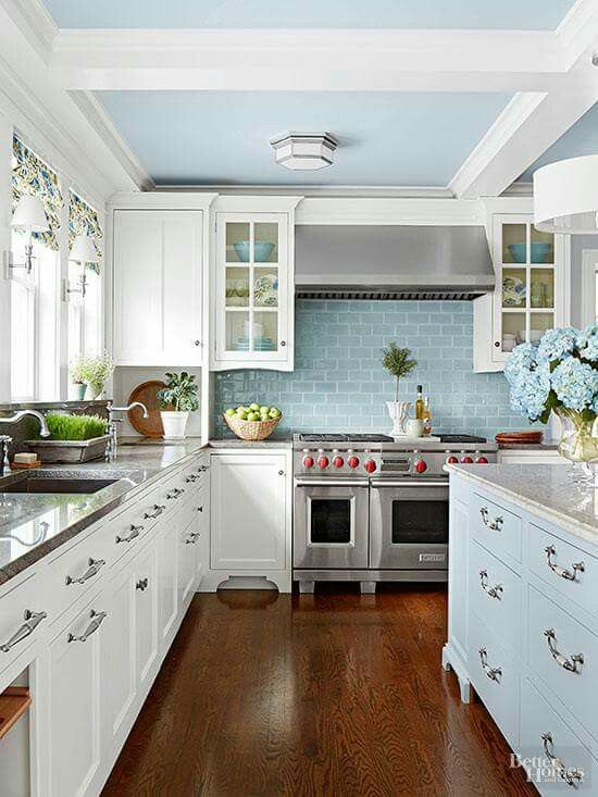 Love the white cabinets and light blue subway tile