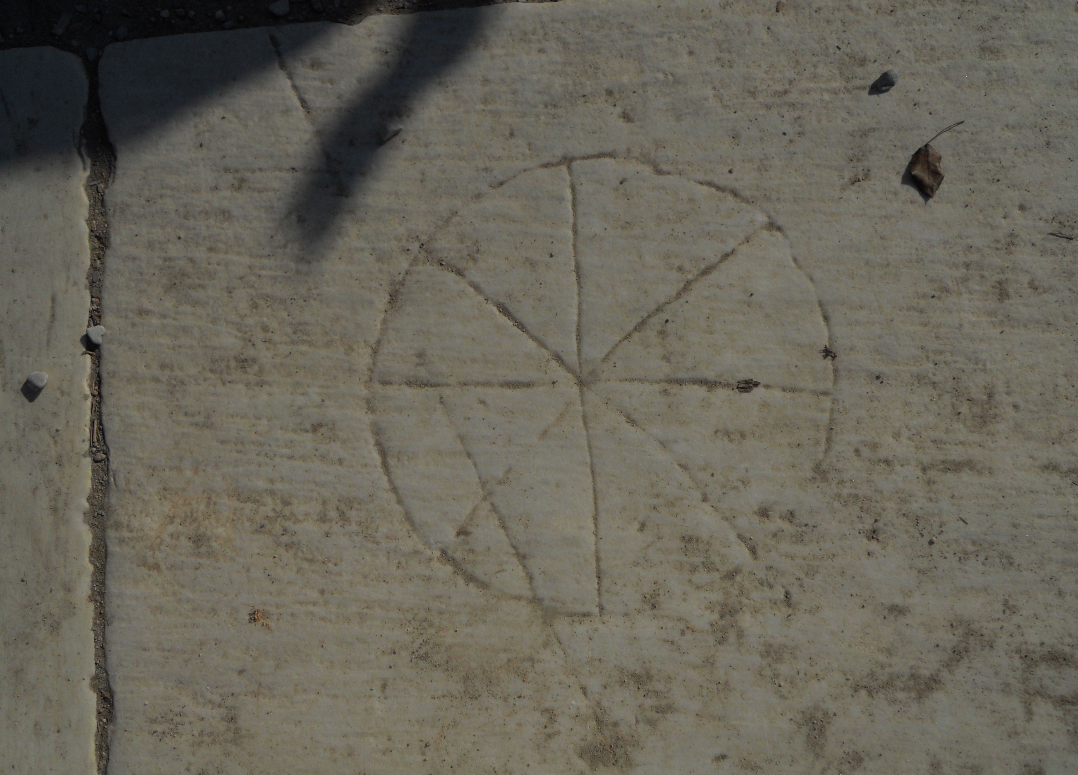 This is the ichthus wheel described in the book the explorers code ichthus wheel ancient carved christian symbol on the marble paving of ephesus turkey biocorpaavc Image collections