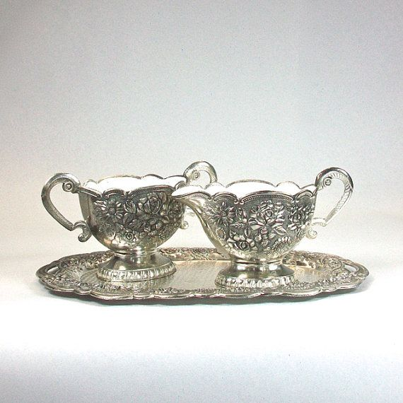 This is a sweet little cream and sugar set with a matching tray. This set is silver plate, it is not marked and the silver content is unknown.