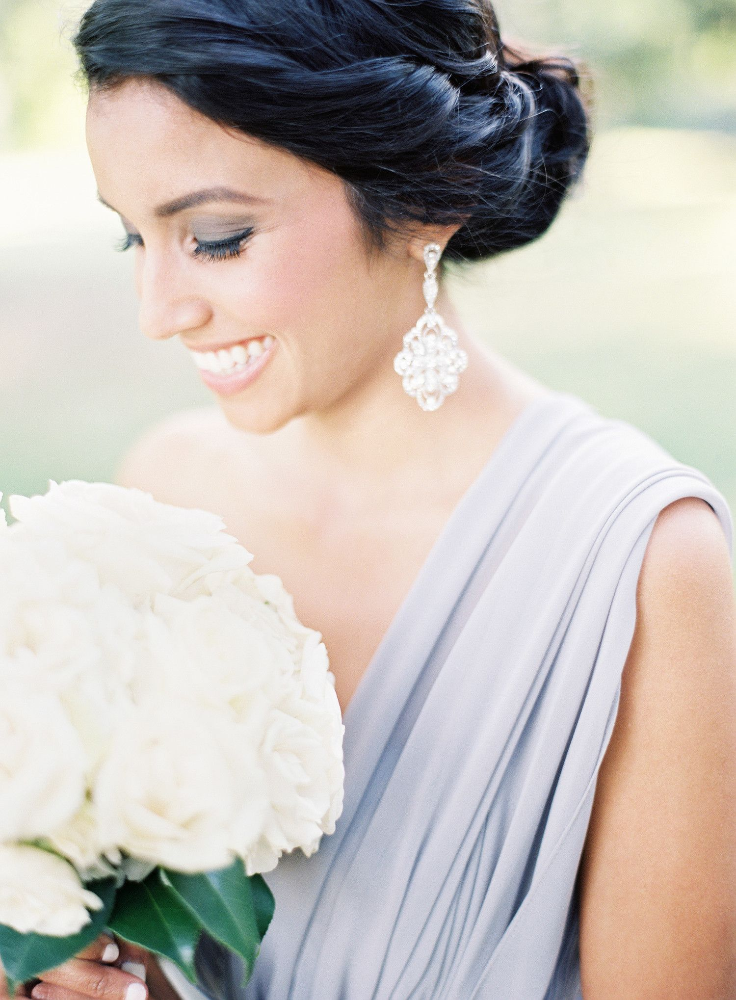 This bridesmaid\'s simple updo was accented with a thick side twist ...
