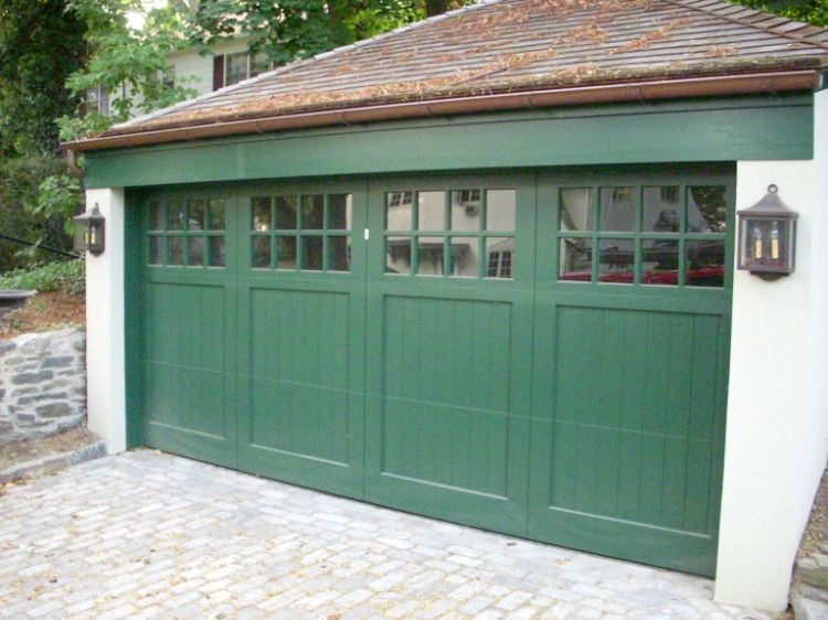 These Green Carriage House Garage Doors With Large Windows Create A Unique And Attractive Design