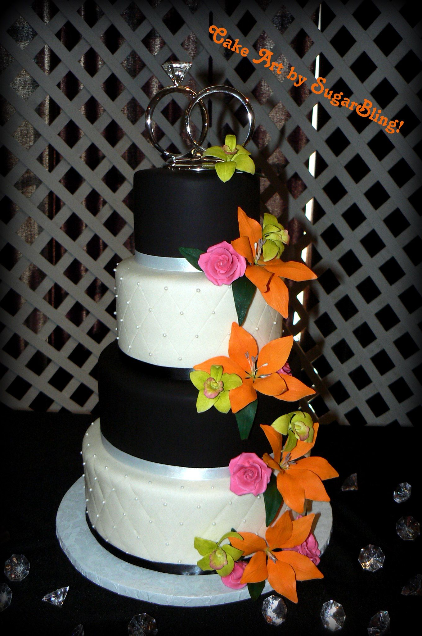 A Tropical Wedding Cake The Orchids Lilies And Roses Are All Made