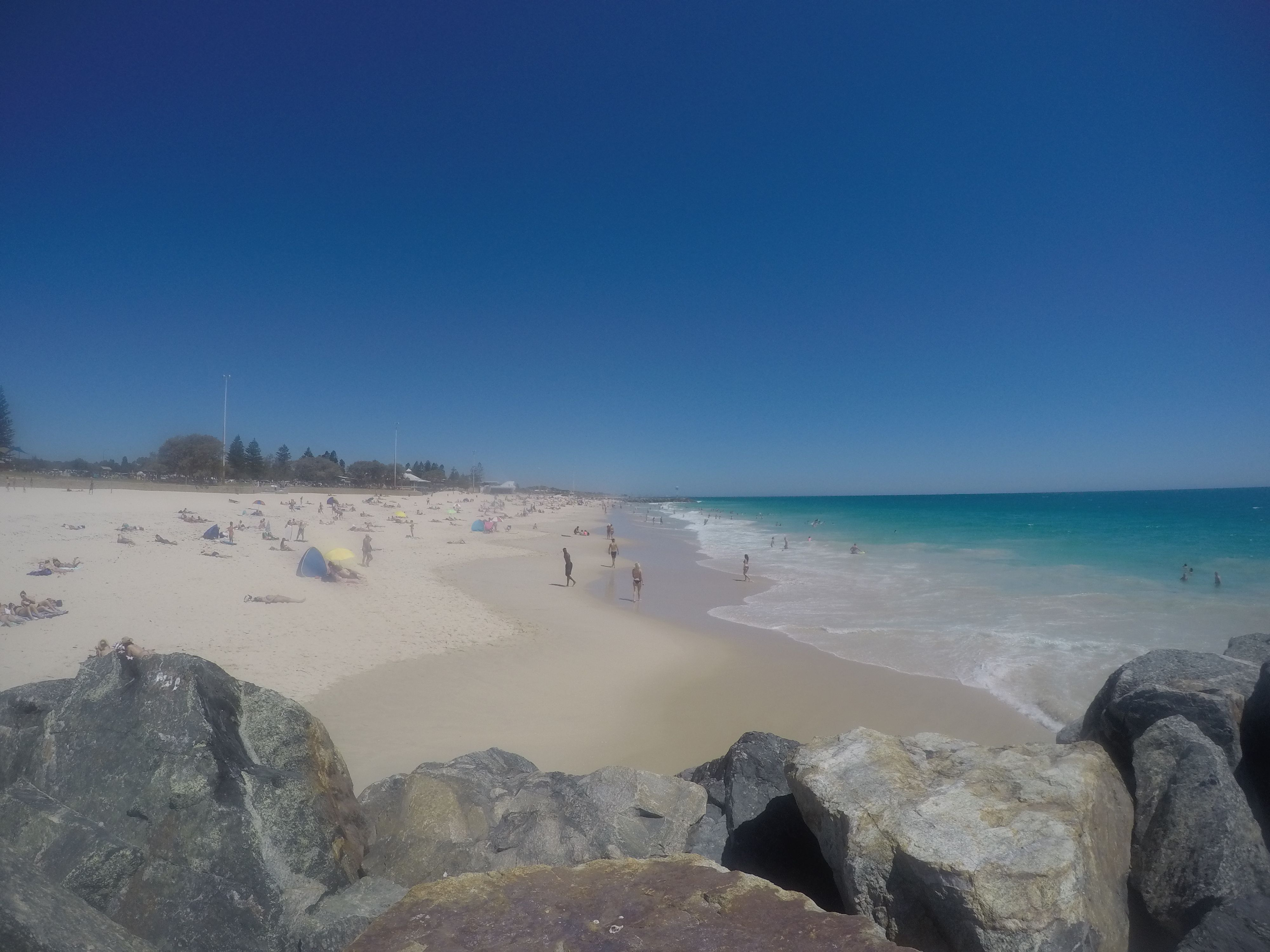 Soaking up the sun and catching waves at Floreat Beach. Today's forecast 37 and awesome.