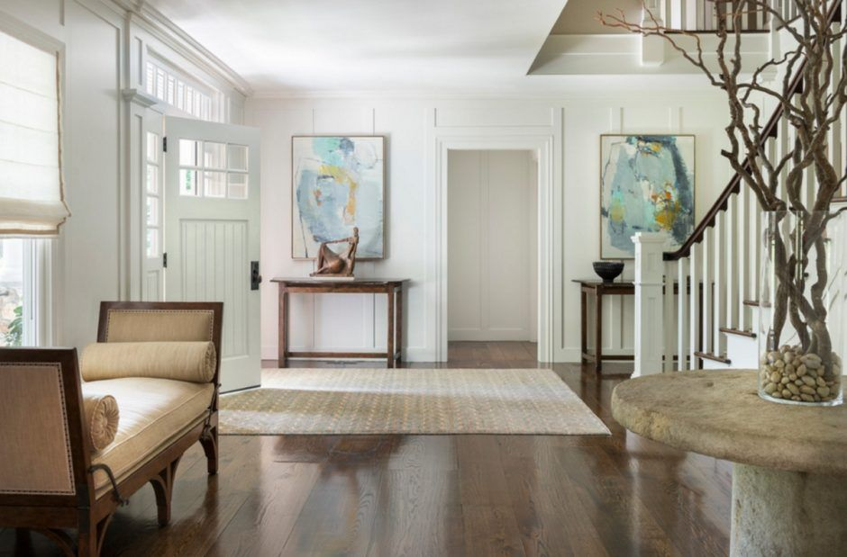 Design Ideas: Large Foyer With Classic Bench And Sculptural Arrangement On A Side Table. classic bench. hardwood flooring. stone round table. decorative branch. abstract painting. table sculptural decor.
