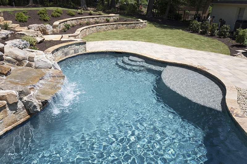 Fujiwa- Glasstel Tahoe 30 Pool Surface. This Beautiful Pool Features Npt Pool Finish Stonescapes Tahoe Blue Greenspace Local Natural Stone And Travertine Pavers Pool Finishes Rectangle Pool Pool