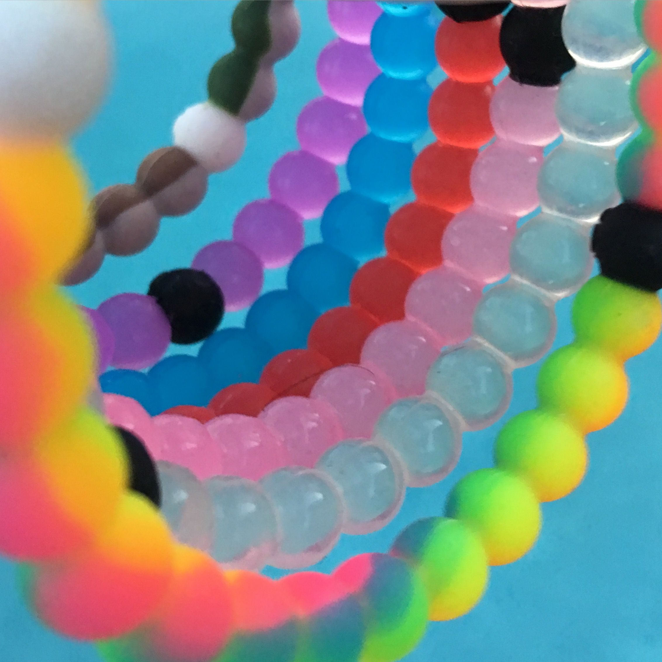 5c6ce2c4bed45 Lokai bracelet stack looking inside over the pool. View from within ...