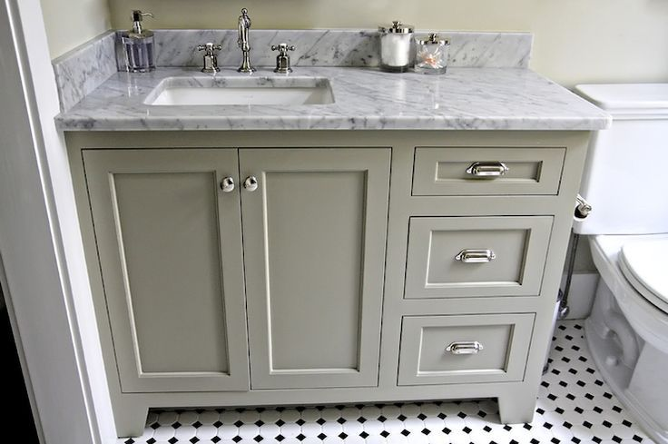Urban Grace Interiors Gray Green Bathroom Cabinets White Carrara Marble Counter Top Polished Nickel Hardware Black Floors And