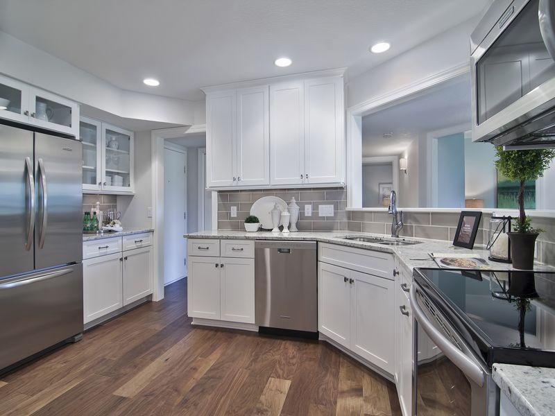 Kitchens · Hardwood Floor: Distressed Walnut Saddle. Diamond Cabinets:  Montgomery Maple In White