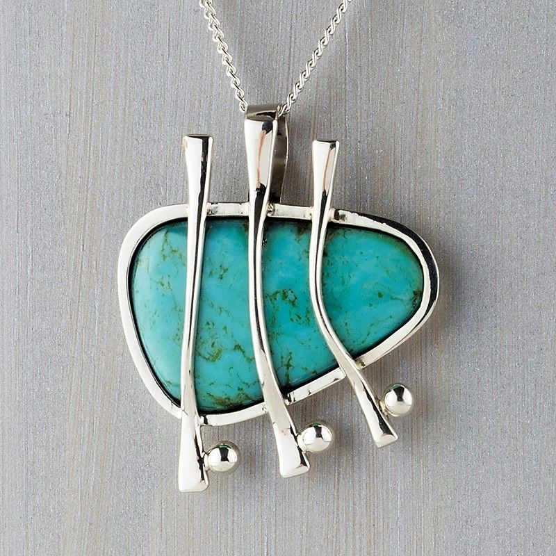 Photo of A chunky natural turquoise stone dangles from a lustrous sterling silver chain w…