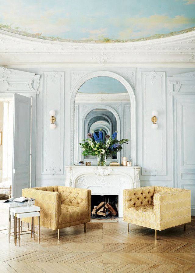 Amazing French Living Space With Matching Yellow Armchairs And A Mosaic Ceiling