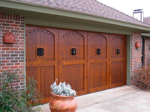 Wood Garage Doors With Windows wood garage door with speakeasy grills and decorative clavos