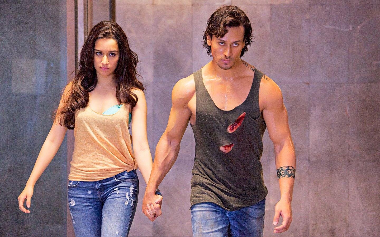 Baaghi Movie Stills Men S Gray Tank Top Movies Bollywood Movies Bollywood Shraddha Kapoor Tiger Shroff 720p Tiger Shroff Bollywood Movies Shraddha Kapoor