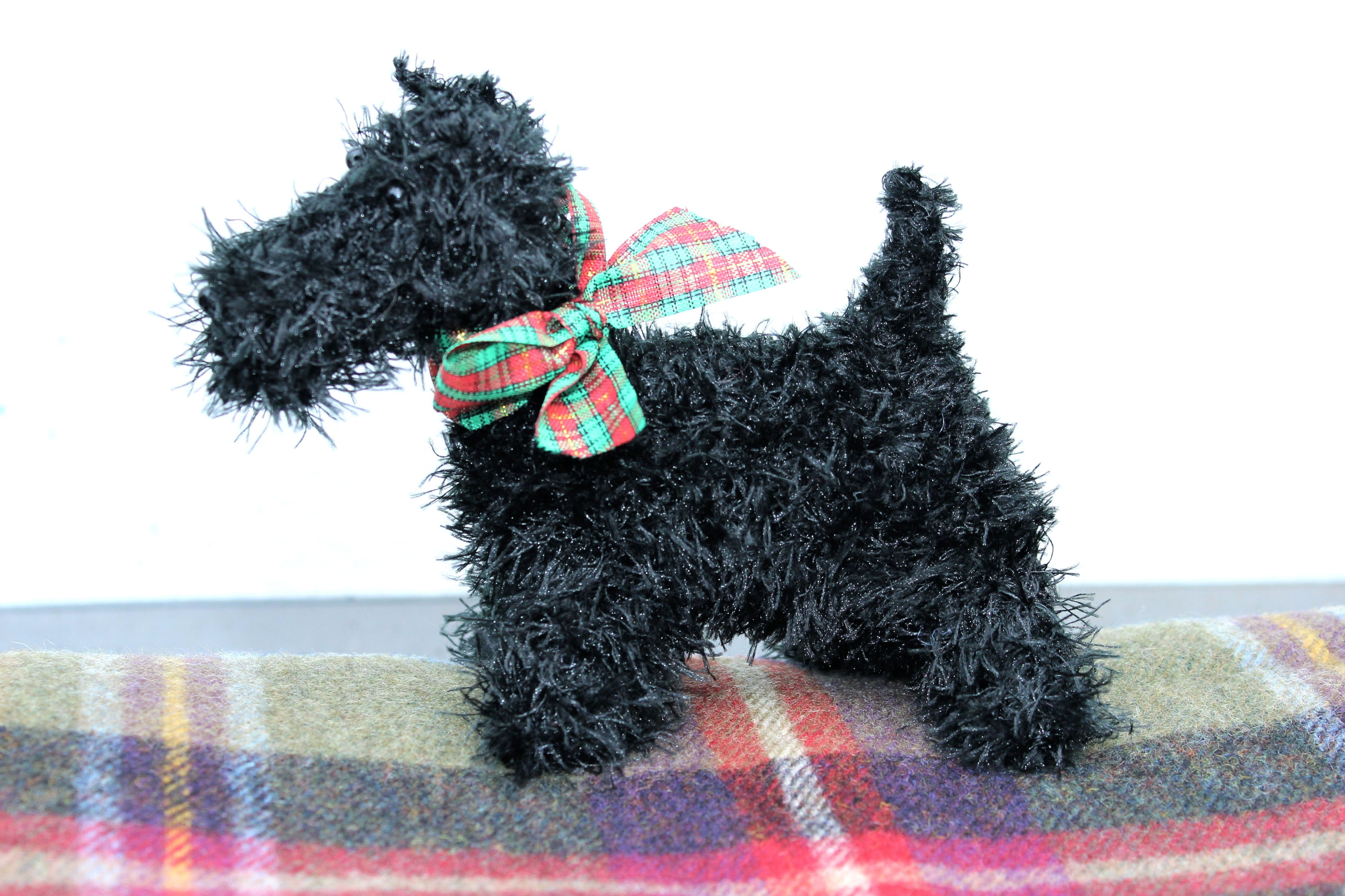 Man's best friend gets the woollen treatment with this adorable knitted scotty dog.
