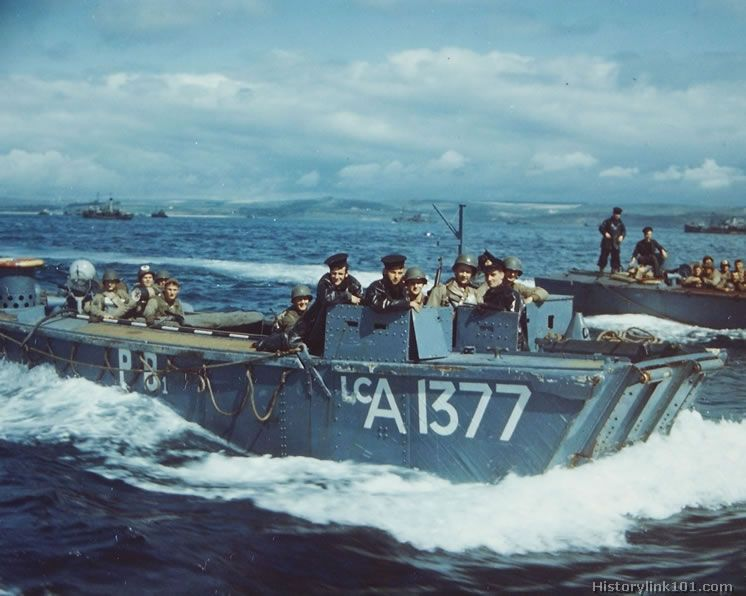 Landing craft loaded with American Troops churn through the waters on their way to a ship in a British Port. These GI's are eager to get sta...