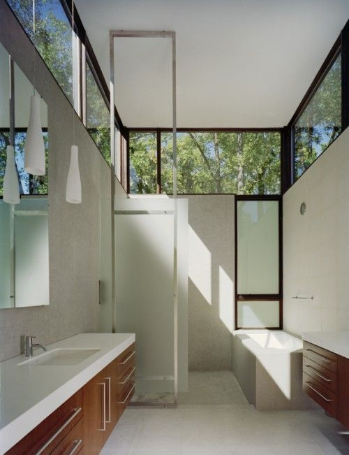 Bathroom with windows topping entire length of each wall - brings light and sense of nature indoors - Designed by Robert M. Gurney