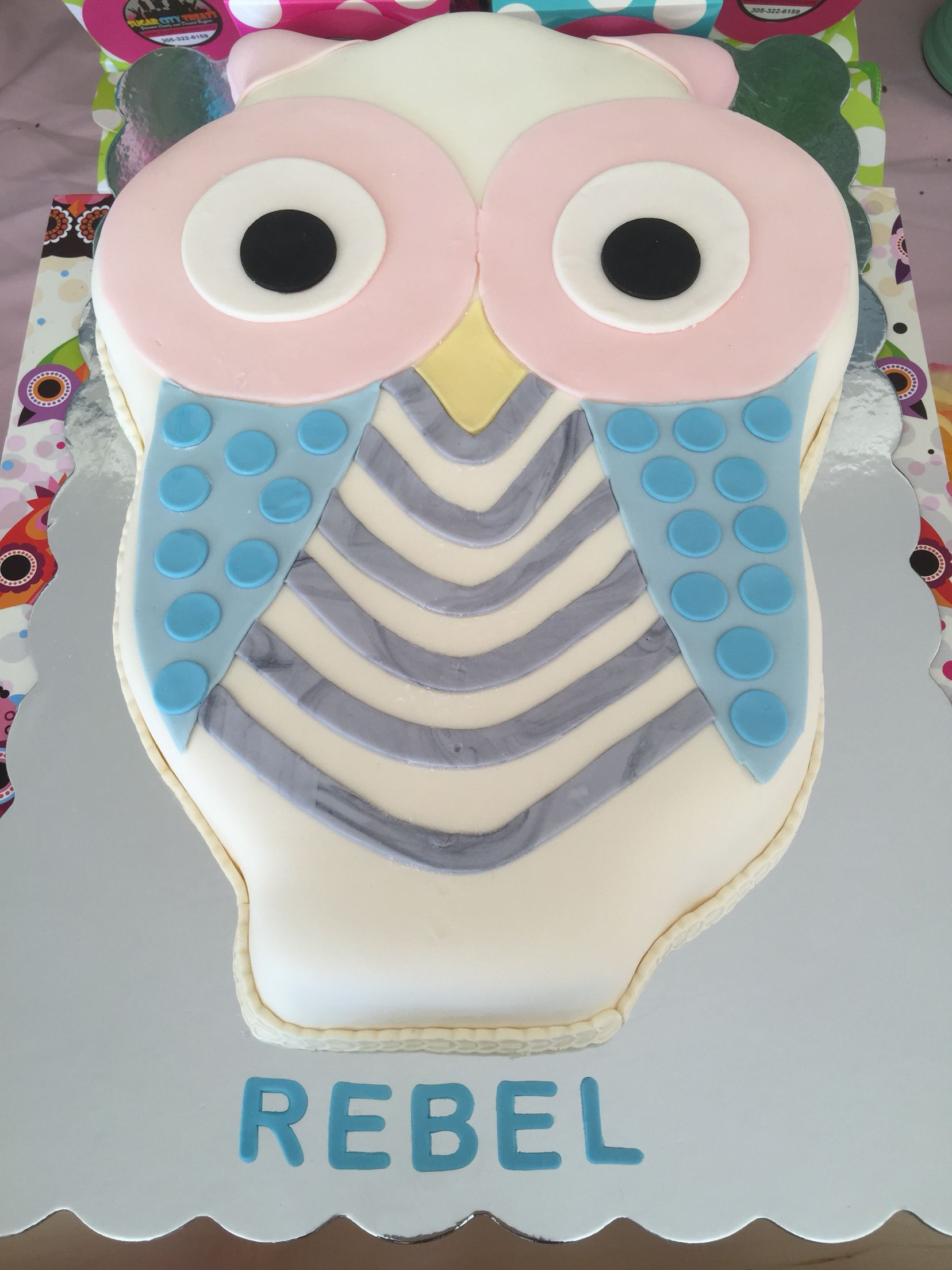 Owl Themed First Birthday Party. Teal, Pink, and Yellow Candy Buffet. Owl shaped cake and custom cupcake toppers.