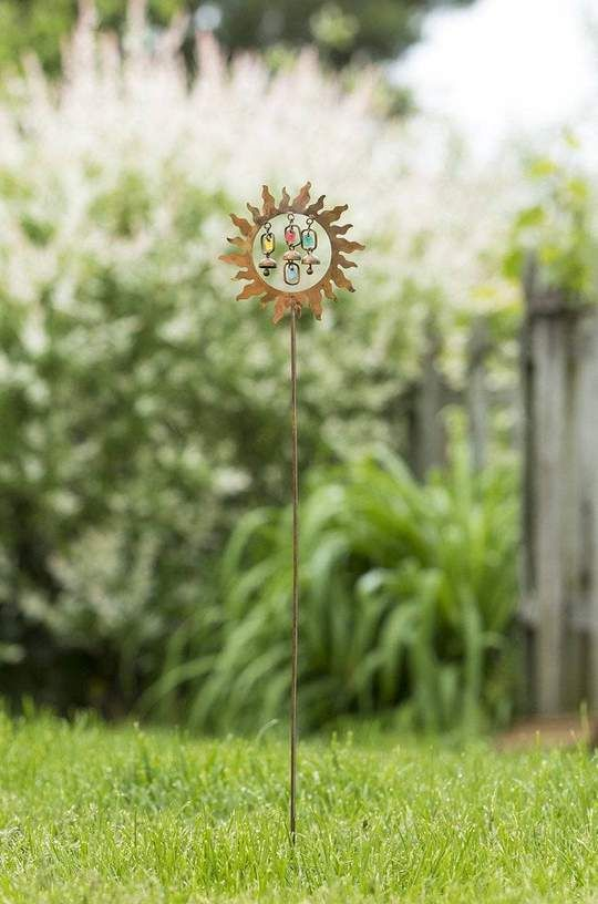 Ah, sunshine and color! Two of our absolute favorite things. Celebrate them both with this funky garden stake, which has been happily handcrafted for a truly unique look and feel. Inside of an iridescent sun, this stake features four little pops of color and two sweet, miniature bells. #garden #gardening #gardenart #gardendecor #gardening #gardenlover #gardenart #gardenstake #gardenstakes Garden | Gardening | Garden Art | Garden Decor | Garden Stake