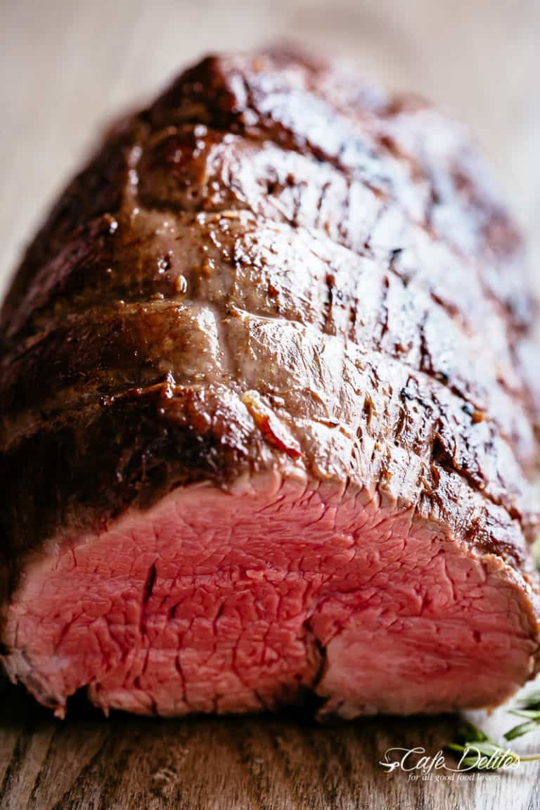 The Best Juicy Roast Beef Tenderloin Slathered With Garlic Butter That Melts In Your Mouth Wi Beef Tenderloin Roast Recipes Beef Tenderloin Tasty Steak Recipe