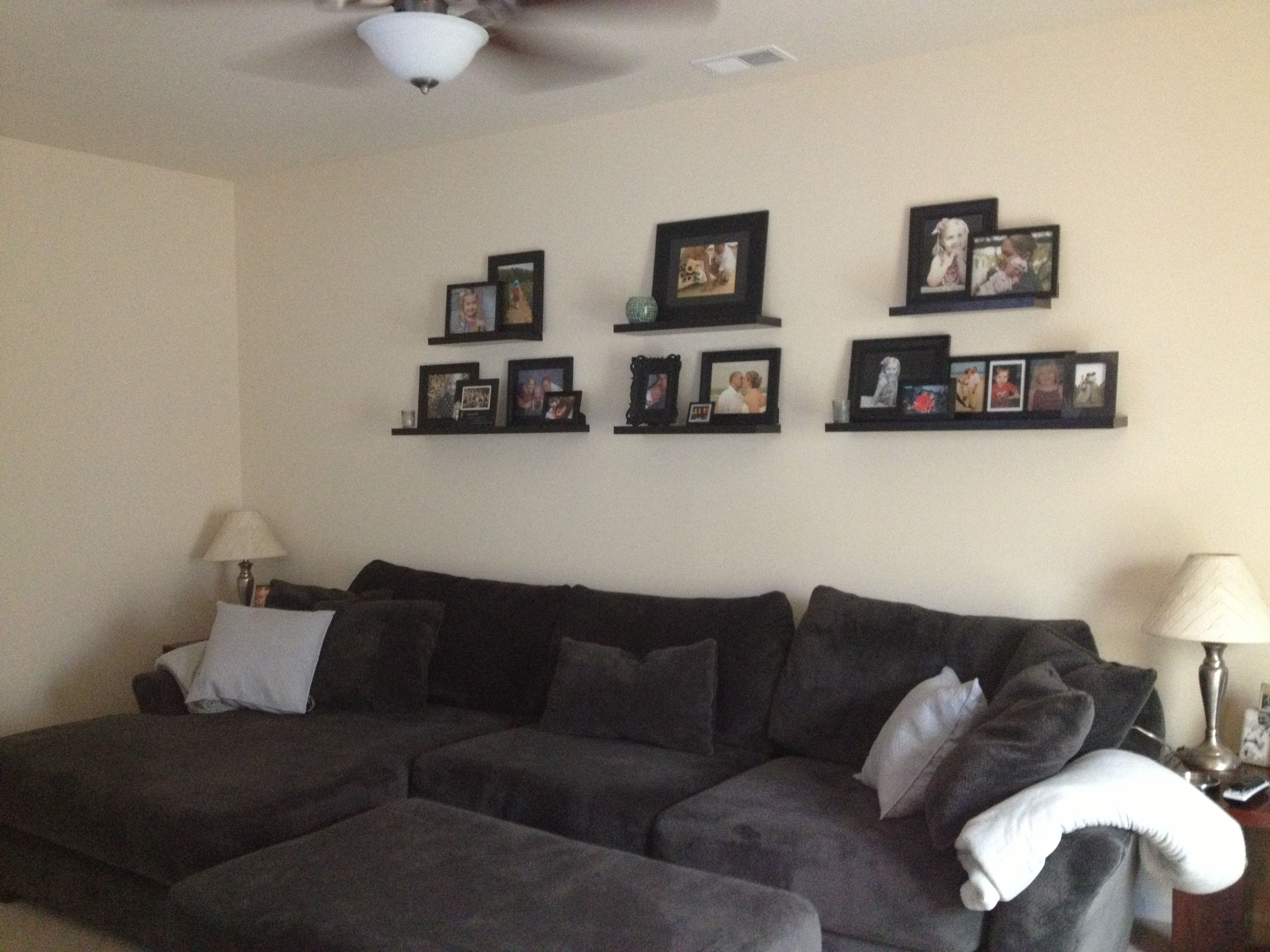 Photo gallery wall Shelves above couch Photo