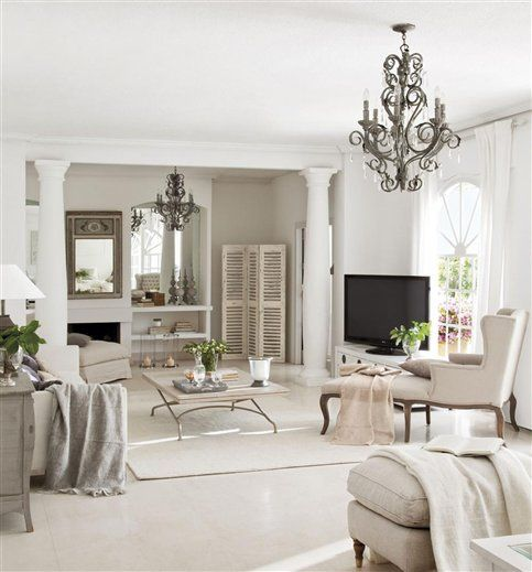 White in Madrid | Inspiring Interiors.  Different angle of other picture which reflects good design and making a large space livable and cozier.