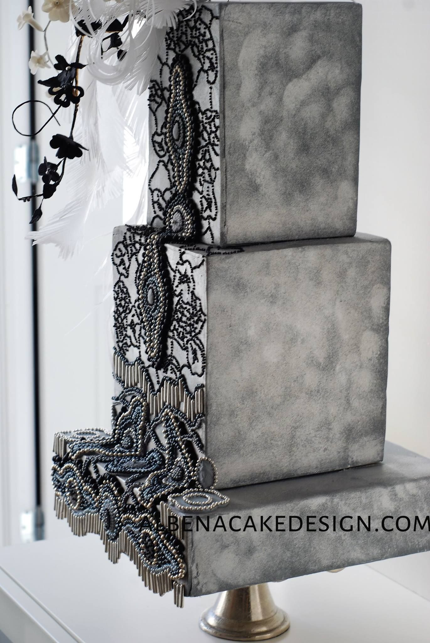 Watercolor gray wedding cake with lace appliqué on satinice