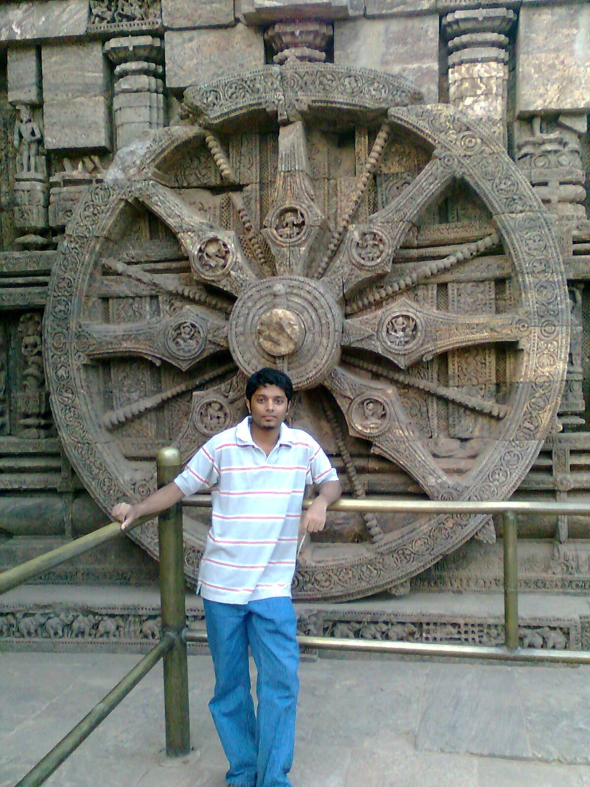 This photo is from my trip to Sun Temple in Konark, Orissa in year 2009 , also known as the Black Pagoda.  It was supposedly built by king Narasimhadeva I of Eastern Ganga Dynasty around 1250. It has been built in the shape of a gigantic chariot with elaborately carved stone wheels, pillars and walls. A major part of the structure is now in ruins. The temple is a UNESCO World Heritage Site.