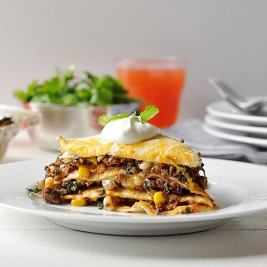 Flour tortillas layered with seasoned beef, corn, and spinach. Topped with lots of cheese!