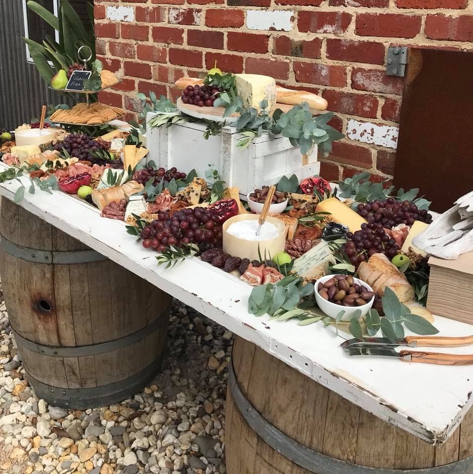 Wedding Grazing Table On A Timber Door And Wine Barrels Yum