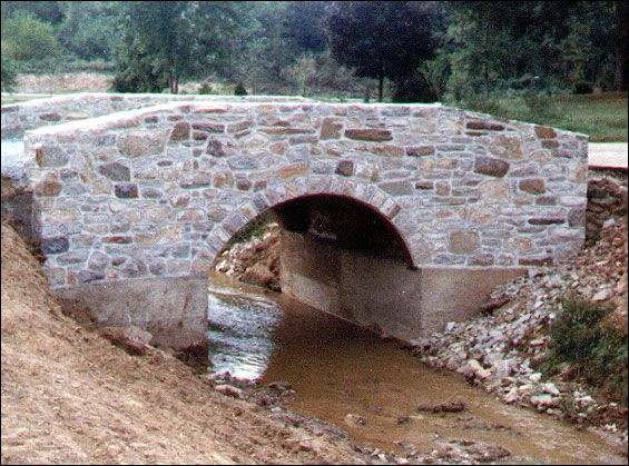 Moat river stream with an elegant bridge over it no need for a draw bridge i want to keep it - Building river stone walls with mortar sobriety and elegance ...