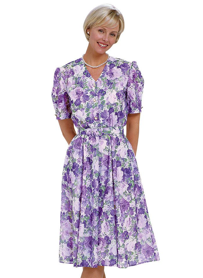 46bdc91925bf0 V-Neck Print Dress is an AmeriMark Exclusive! Elegant lavender and purple  rose print, modest neckline. 8P to 24W.