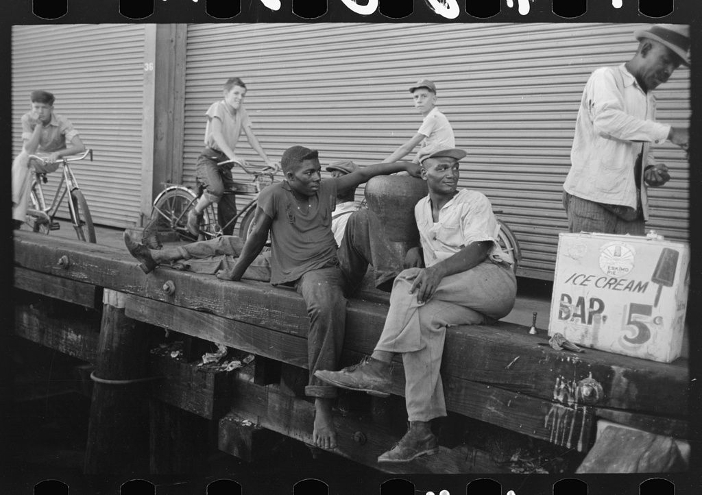 People sitting on dock, New Orleans, Louisiana. 1938 Sept. Library of Congress.