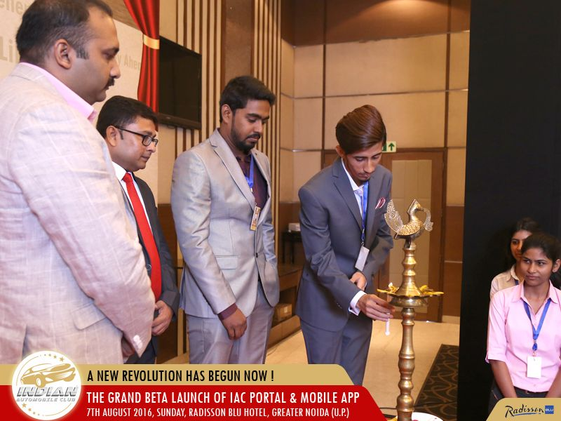 Co Founder & CEO lighting the lamp.