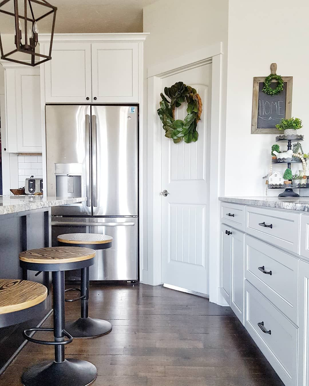 farmhouse kitchen with pewter glazed white cabinets and black distressed island our farmhouse on farmhouse kitchen hutch id=71466