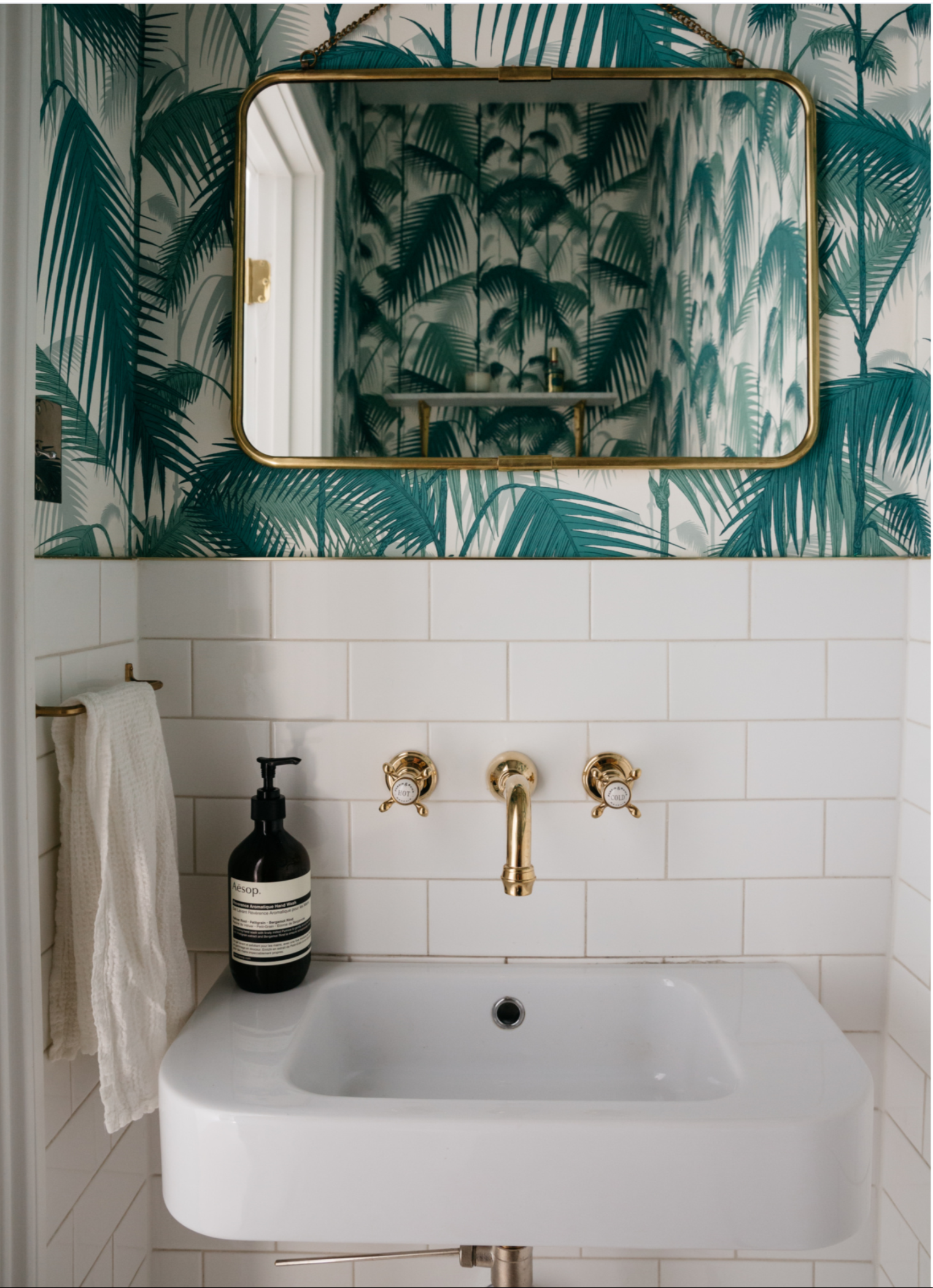 powder room fun tile with jungle wallpaper above