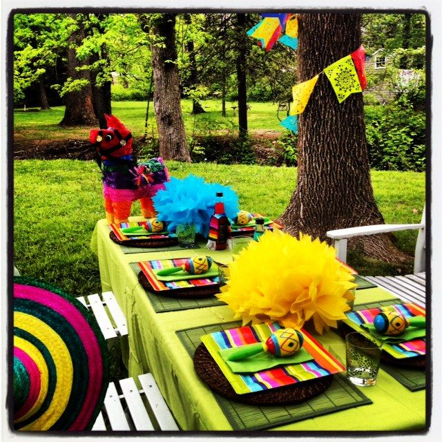 Love the paper flowers, pinata, and  papel picado around trees