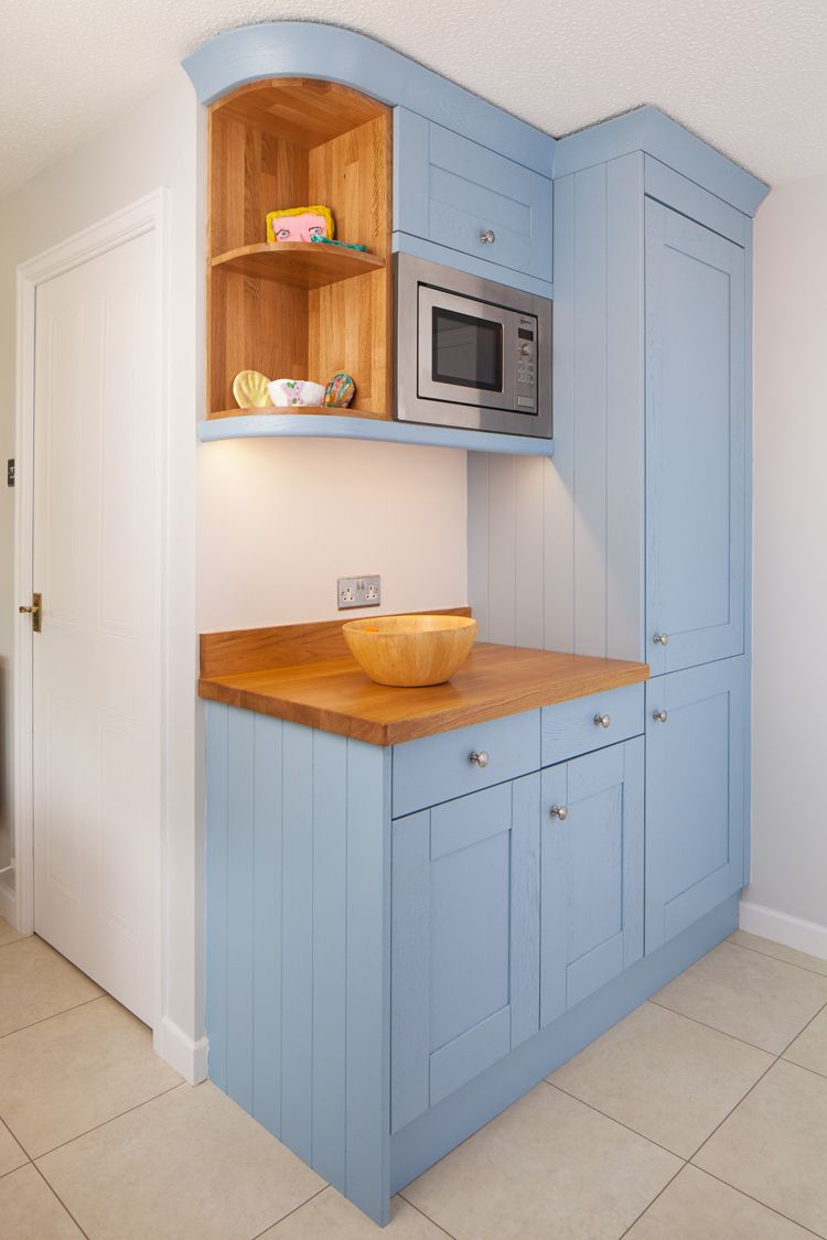 This lulworth blue kitchen features a variety of cabinetry for Kitchen wall cabinets
